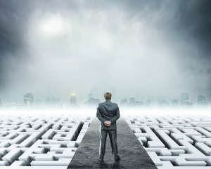 Businessman standing on labyrinth, metaphor for facing difficulties in business and the stress of daily life